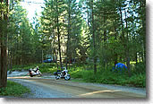 Motorcycle camping in the trees